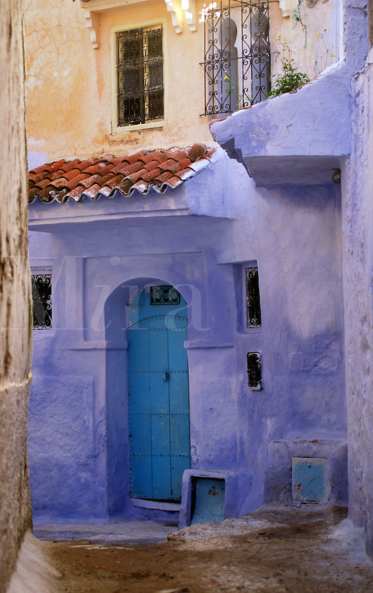 HOUSES in the MEDINA are painted beautiful pastel colors in CHECHAOUEN in the RIF MOUNTAINS of MOROCCO
