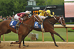 HOT SPRINGS, AR - APRIL 9: Terra Promessa #2 with jockey Ricardo Santana, Jr., holding off Taxable #1 with jockey Joseph Rocco, Jr. before crossing the finish line in the Fantasy Stakes at Oaklawn Park on April 9, 2016 in Hot Springs, Arkansas. (Photo by Justin Manning/Elipse Sportwire/Getty Images)