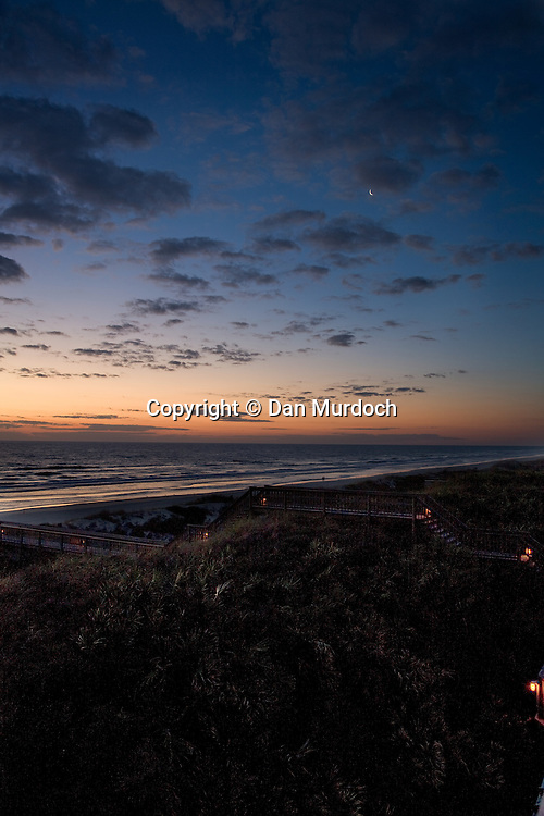Beautiful sunrise over beach and sand dunes on Crescent Beach, St. Augustine, Florida