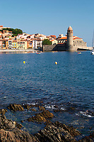 The church Eglise Notre Dame des Anges, our lady of the angels. With its emblematic church tower. The beach in the village. Collioure. Roussillon. France. Europe.