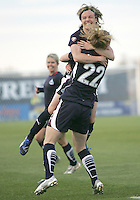 Sonia Bompastor #8 of the Washington Freedom hugs Becky Sauerbrunn #22 after her goal during a WPS match against the Chicago Red Stars at Maryland Soccerplex on April 11 2009, in Boyd's, Maryland. The game ended in a 1-1 tie