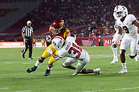 LOS ANGELES, CA - SEPTEMBER 11: Keaontay Ingram #28 of the USC Trojans is tackled by Zahran Manley #31 of the Stanford Cardinal during a game between University of Southern California and Stanford Football at Los Angeles Memorial Coliseum on September 11, 2021 in Los Angeles, California.