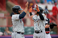 Akron RubberDucks Alexis Pantoja (1) is congratulated at home by Nellie Rodriguez (12) after hitting a home run during an Eastern League game against the Erie SeaWolves on June 2, 2019 at UPMC Park in Erie, Pennsylvania.  Akron defeated Erie 7-2 in the first game of a doubleheader.  (Mike Janes/Four Seam Images)