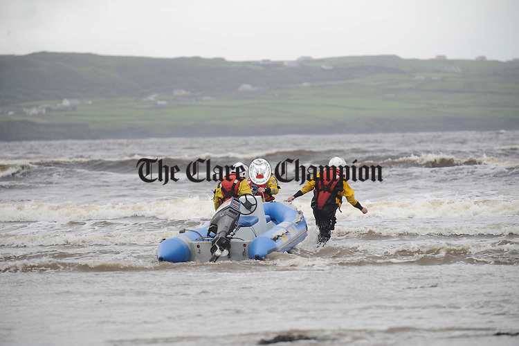 Members of the Doolin coastguard work to recover a rib which was set loose at the pier and later grounded on rocks by strong gales in Liscannor on Tuesday night. Photograph by John Kelly. Members of the Doolin coastguard preparing to tow to safety a rib which was set loose at the pier and later grounded on rocks by strong gales in Liscannor on Tuesday night. Photograph by John Kelly.