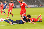 Minamino Takumi of Japan falls with Saad Al Mukhaini of Oman as they fight for the ball during the AFC Asian Cup UAE 2019 Group F match between Oman (OMA) and Japan (JPN) at Zayed Sports City Stadium on 13 January 2019 in Abu Dhabi, United Arab Emirates. Photo by Marcio Rodrigo Machado / Power Sport Images