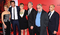 """NEW YORK, NY - NOVEMBER 20: Elizabeth Banks, Liam Hemsworth, Jennifer Lawrence, Francis Lawrence, Philip Seymour Hoffman, Stanley Tucci at the New York Premiere Of Lionsgate's """"The Hunger Games: Catching Fire"""" held at AMC Lincoln Square Theater on November 20, 2013 in New York City. (Photo by Jeffery Duran/Celebrity Monitor)"""