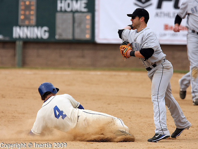SIOUX FALLS, SD - MAY 17: Joe Anthonen #4 of the Sioux Falls Canaries slides hard into second as Ron Fenwick #13 of the St. Paul Saints throws to first for a double play in the eighth inning Sunday afternoon at the Sioux Falls Stadium. (Photo by Dave Eggen/Inertia).