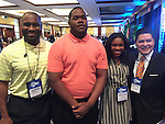 SAT superstars Matthew Blue and Valencia Grayson flanked by Valencia's father Vincent (left) and HISD Superintendent Richard Carranza (right) at Council of the Great City Schools in Miami.