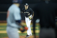Wake Forest Demon Deacons relief pitcher Ryan Cusick (33) looks to his catcher for the sign against the Illinois Fighting Illini at David F. Couch Ballpark on February 16, 2019 in  Winston-Salem, North Carolina.  The Fighting Illini defeated the Demon Deacons 5-2. (Brian Westerholt/Four Seam Images)