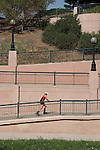 Female Caucasian inline skater at Confluence Park along Cherry Creek in Denver, Colorado, USA .  John offers private photo tours in Denver, Boulder and throughout Colorado. Year-round Colorado photo tours.