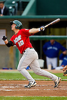 Chris Burke (10) of the Fort Wayne TinCaps follows through on his swing against the Lansing Lugnuts at Cooley Law School Stadium on June 5, 2013 in Lansing, Michigan.  The TinCaps defeated the Lugnuts 8-5.  (Brian Westerholt/Four Seam Images)