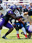 TCU Horned Frogs safety Elisha Olabode (6) and Virginia Cavaliers running back Perry Jones (33) in action during the game between the Virginia Cavaliers and the TCU Horned Frogs  at the Amon G. Carter Stadium in Fort Worth, Texas. TCU defeats Virginia 27 to 7...