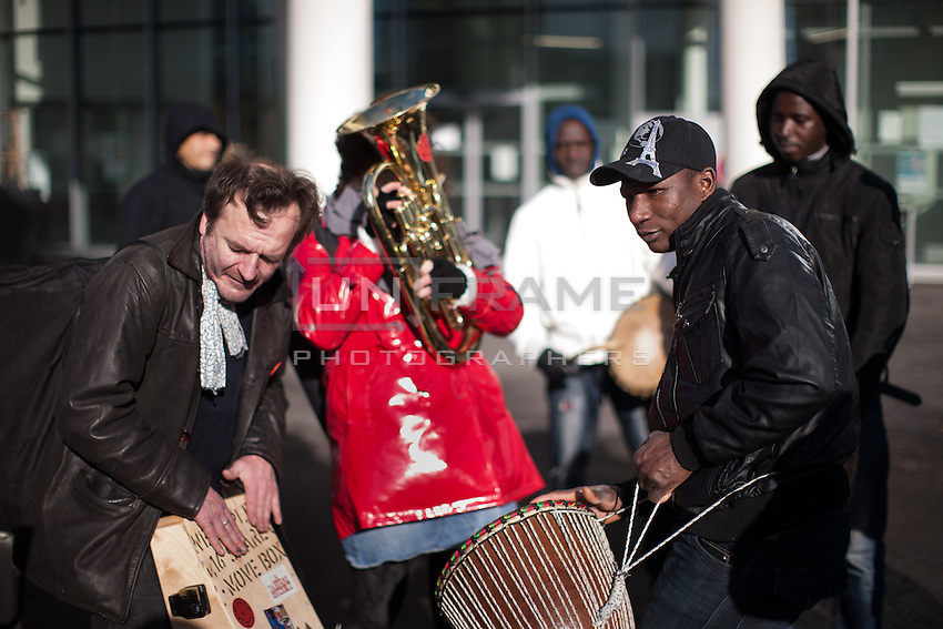 Musicians take part in a rally held by The Baras Collective in front of the Bagnolet Town Hall today as they continue to fight an expulsion from 72 René Alazard in Bagnolet, suburb of Paris, France. Jan. 31, 2015.