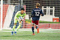 FOXBOROUGH, MA - OCTOBER 16: Carlos Avilez #1 of North Texas SC gathers the ball as Justin Rennicks #12 of New England Revolution II approaches during a game between North Texas SC and New England Revolution II at Gillette Stadium on October 16, 2020 in Foxborough, Massachusetts.