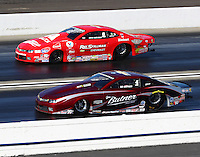 Feb 12, 2017; Pomona, CA, USA; NHRA pro stock driver Bo Butner (near) races alongside Drew Skillman during the Winternationals at Auto Club Raceway at Pomona. Mandatory Credit: Mark J. Rebilas-USA TODAY Sports