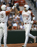 Texas CF Jordan Danks is greeted by teammate Kyle Russell (19) against Texas A&M on May 16th, 2008 in Austin Texas. Photo by Andrew Woolley / Four Seam Images.