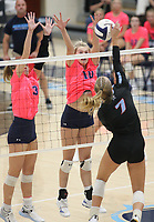 Olivia Melton of Southside spikes the ball as Caylan Koons (3) and Kat Cooper (10) of Har-ber go up for block on Tuesday, October 12, 2021, during play at Wildcat Arena, Springdale. Visit nwaonline.com/211013Daily/ for today's photo gallery.<br /> (Special to the NWA Democrat-Gazette/David Beach)
