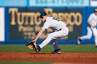 Michigan Wolverines shortstop Jack Blomgren (18) fields a ground ball during a game against Army West Point on February 18, 2018 at Tradition Field in St. Lucie, Florida.  Michigan defeated Army 7-3.  (Mike Janes/Four Seam Images)