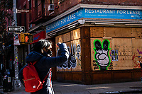 NEW YORK, NY - NOVEMBER 23: People walk near a restaurant closed by the pandemic as the global outbreak of the coronavirus disease (COVID-19) continues increase on November 23, 2020 in New York.  NYC Mayor tells city to prepare for second wave shutdown where Indoor dining, gyms, restaurants and lots of other businesses would have to close until the coronavirus infection rate dies down. (Photo by Eduardo MunozAlvarez/VIEWpress)