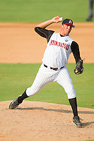 Relief pitcher Chase Cooney #39 of the Kannapolis Intimidators in action against the Hagerstown Suns at Fieldcrest Cannon Stadium August 8, 2010, in Kannapolis, North Carolina.  Photo by Brian Westerholt / Four Seam Images