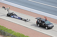 Apr. 7, 2013; Las Vegas, NV, USA: NHRA top fuel dragster drivers Antron Brown and Clay Millican hanging out the windows of the tow vehicle on the return road during the Summitracing.com Nationals at the Strip at Las Vegas Motor Speedway. Mandatory Credit: Mark J. Rebilas-