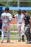 GCL Marlins Sleyter Soto (11) greets Colby Lusignan (45) after a home ru during a game against the GCL Mets on August 12, 2016 at St. Lucie Sports Complex in St. Lucie, Florida.  GCL Marlins defeated GCL Mets 8-1.  (Mike Janes/Four Seam Images)