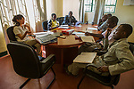 Cheetah (Acinonyx jubatus) conservationist, Kim Young-Overton, talking with commanders about anti-poaching strategies, Kafue National Park, Zambia