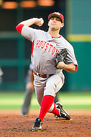 Relief pitcher Jordan Mannisto #20 of the Houston Cougars in action against the Texas Tech Red Raiders at Minute Maid Park on March 4, 2012 in Houston, Texas.  The Red Raiders defeated the Cougars 10-4.  Brian Westerholt / Four Seam Images