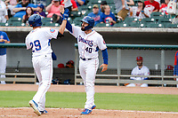 Tennessee Smokies right fielder Vance Vizcaino (29) celebrates a home run with teammate Tyler Payne (40) during the game against the Montgomery Biscuits on May 9, 2021, at Smokies Stadium in Kodak, Tennessee. (Danny Parker/Four Seam Images)