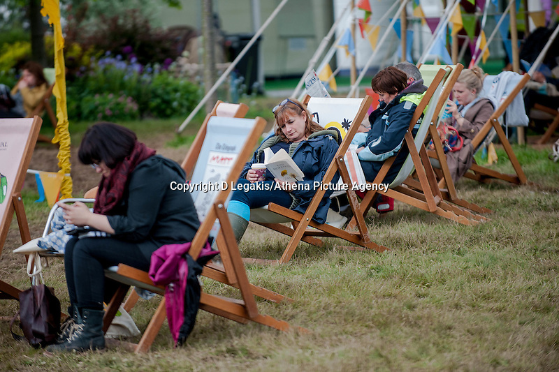 Thursday  29 May 2014, Hay on Wye, UK<br /> Pictured: People relax on the green at the hay festival<br /> Re: The Hay Festival, Hay on Wye, Powys, Wales UK.