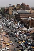 Congested early morning traffic blocks Sharia Pasha al Mek, a main thoroughfare in Souq Al-Arabi in central Khartoum.