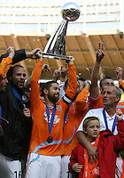 Houston captain Wade Barrett and teammates celebrate their victory. The Houston Dynamo defeated the New England Revolution 2-1 in the finals of the MLS Cup at RFK Memorial Stadium in Washington, D. C., on November 18, 2007.