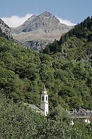 Switzerland. Canton of Ticino. Val di Blenio (Blenio valley). Village of Dangio. Catholic church. Bell tower. Pian Premesti mountain. © 2006 Didier Ruef