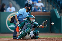 Greensboro Grasshoppers catcher Will Banfield (18) receives a pitch as home plate umpire Josh Gilreath looks on during the game against the West Virginia Power at First National Bank Field on August 9, 2018 in Greensboro, North Carolina. The Power defeated the Grasshoppers 5-3 in game one of a double-header. (Brian Westerholt/Four Seam Images)