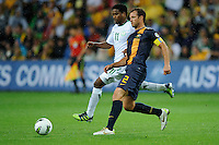 Lucas NEILL (2) of Australia and Nasser AL SHAMRANI (11) of Saudi Arabia run with the ball during the FIFA 2014 World Cup Group D Asian Qualifier match between Australia and Saudi Arabia at AAMI Park in Melbourne, Australia...This image is not for sale on this web site. Please contact Southcreek Global Media for licensing:.Toll Free: 1.800.934.5030.Canada: 701 Rossland Rd. East, Suite 315, Whitby, Ontario, Canada, L1N 9K3.USA: 10792 Baron Dr, Parma OH, USA 44130.Web: http://southcreekglobal.net/ and http://southcreekglobal.com/