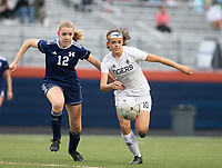 Allie Sullivan (12) of Rogers Heritage<br /> and Amanda Schell (10) of Bentonville<br /> going for the ball at David Gates Stadium, Rogers, Ark., on Tuesday,, March 30, 2021  / Special to NWA Democrat-Gazette/ David Beach