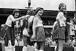 Isle of Man, Peel annual carnival 1970s. Teenager girls of a float thats gets pulled around town. Girls having a bit of fun, lifting up another girls dress, her tartan skirt exposing her knickers. Everyone laughing. 1978