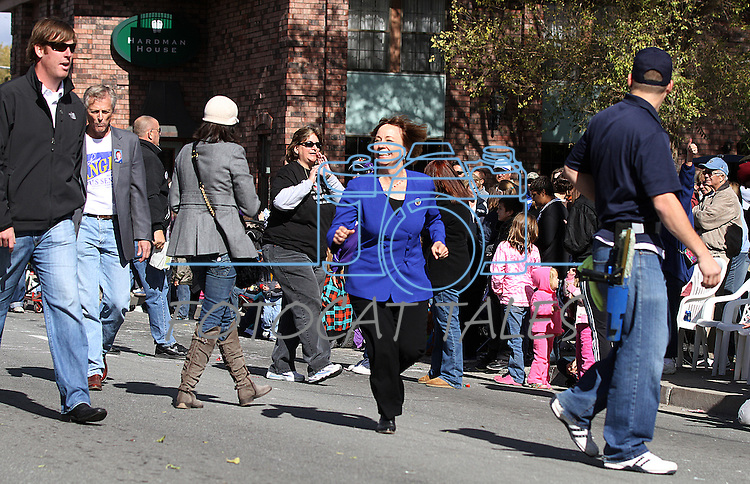 U.S. Senate candidate Sharron Angle jogs down Carson Street to catch up to her float on Saturday during the Nevada Day parade in Carson City, Nev. .Photo by Cathleen Allison