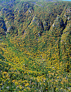 Looking down into King Ravine from Chemin Des Dames Trail in the Northern Presidential Range of the White Mountains, New Hampshire USA during the autumn season. Snow can be found in the ice caves of this ravine during the summer months