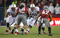 SEATTLE, WA - September 28, 2013: Stanford center Khalil Wilkes, far left, and guard Joshua Garnett, second from right, block Washington State nose tackle Kalafitoni Pole, second from left, and linebacker Cyrus Coen Stanford against Washington State at CenturyLink Field. Stanford won 55-17