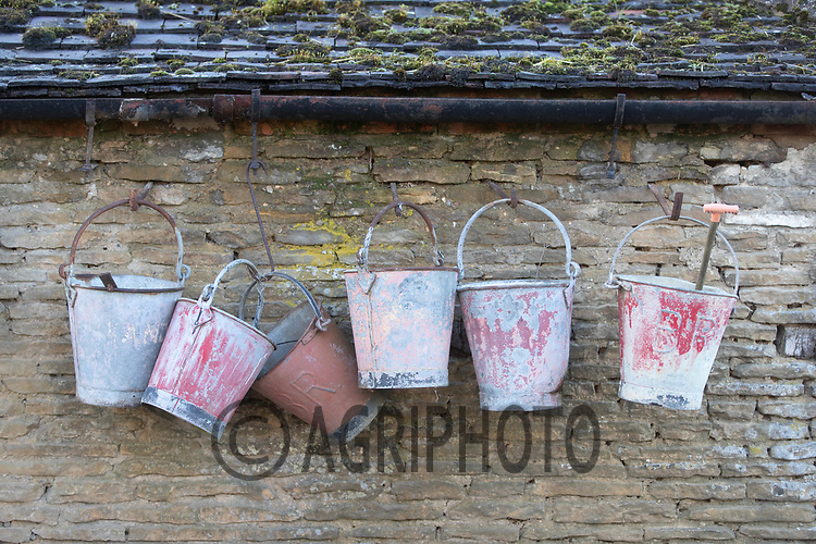 18-2-2021 Old Buckets hanging in a farmyard<br /> ©Tim Scrivener Photographer 07850 303986<br />      ....Covering Agriculture In The UK....