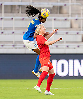 ORLANDO, FL - FEBRUARY 24: Bruna #3 of Brazil goes up for a header with Sophie Schmidt #13 of Canada during a game between Brazil and Canada at Exploria Stadium on February 24, 2021 in Orlando, Florida.