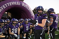 Fayetteville players prepare to take the field, Friday, October 9, 2020 during a football game at Fayetteville High School in Fayetteville. Check out nwaonline.com/2010010Daily/ for today's photo gallery. <br /> (NWA Democrat-Gazette/Charlie Kaijo)