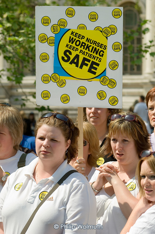 Nurses wait outside Central Hall, Westminster, during a lobby of Parliament to protest at NHS redundancies.
