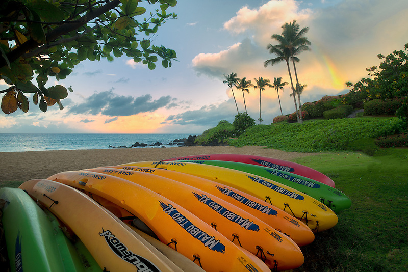 Kayaks on beach with rainbow. Maui, Hawaii