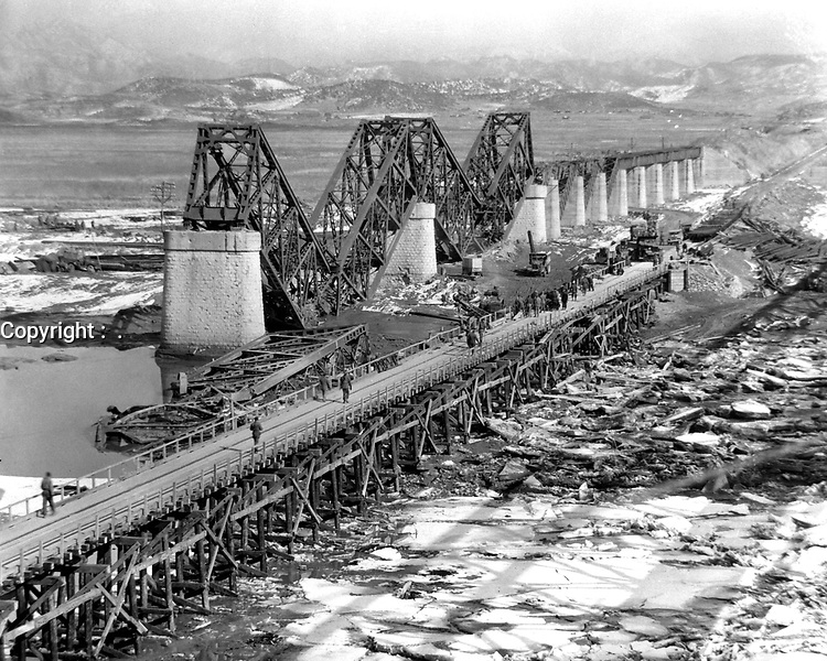 """""""Freedom Gate Bridge"""" spanning the Imjin River, built by the 84th Engineer Construction Bn.  This bridge temporarily replaces the original structure which was destroyed by bombs.  March 10, 1952.  G. Dimitri Boria. (Army)<br /> NARA FILE #:  111-SC-410709<br /> WAR & CONFLICT BOOK #:  1407"""