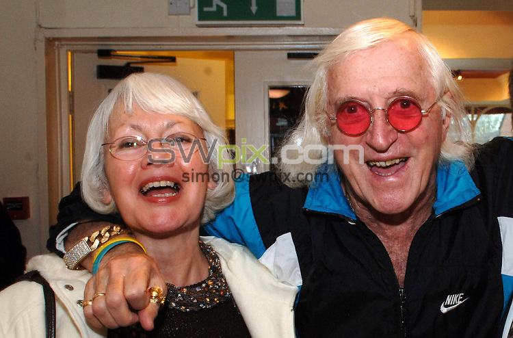 FILE PICTURE RE ISSUED 12/01/2013 Pix by Simon Wilkinson/SWpix.com.....Feature, Sir Jimmy Savile, 11.1.06..Picture Copyright >> Simon Wilkinson >> 07811267706>>..Sir Jimmy Savile pictured at the Flying Pizza resturant, Leeds with a close friend and confidant