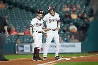 Mississippi State Bulldogs third base coach Mike Brown chats with Tanner Poole (12) during the game against the Houston Cougars in game six of the 2018 Shriners Hospitals for Children College Classic at Minute Maid Park on March 3, 2018 in Houston, Texas. The Bulldogs defeated the Cougars 3-2 in 12 innings. (Brian Westerholt/Four Seam Images)