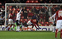 Pictured: Ricardo Vaz Te (C) of Barnsley tumbles onto the ground after scoring his second goal.  Saturday 07 January 2012<br /> Re: FA Cup football Barnsley FC v Swansea City FC at the Oakwell Stadium, south Yorkshire.