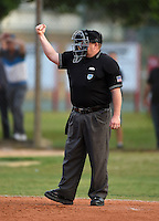 Home plate umpire makes a call during a Lake Mary Rams game against the Lake Brantley Patriots on April 2, 2015 at Allen Tuttle Field in Lake Mary, Florida.  Lake Brantley defeated Lake Mary 10-5.  (Mike Janes/Four Seam Images)